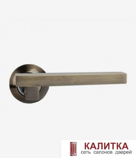 Ручка дверная  на круглом основании 92 AB PREMIUM (бронза)